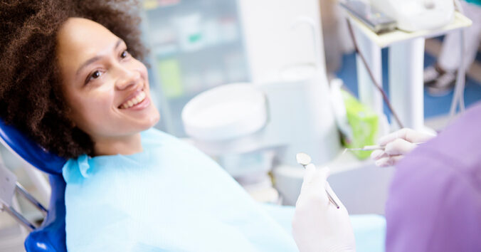Patient smiles in dental chair